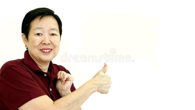 Polegar superior asiático que sorri acima no fundo branco do isolado imagens de stock
