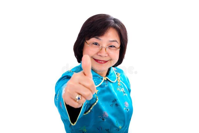 Polegares asiáticos da mulher acima fotografia de stock