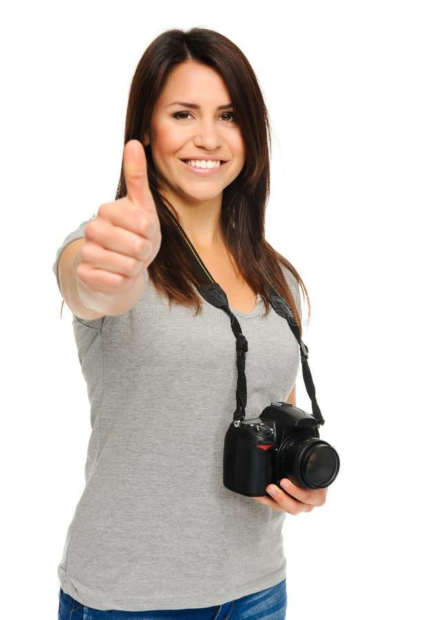 Polegares bonitos da mulher acima com câmera fotografia de stock