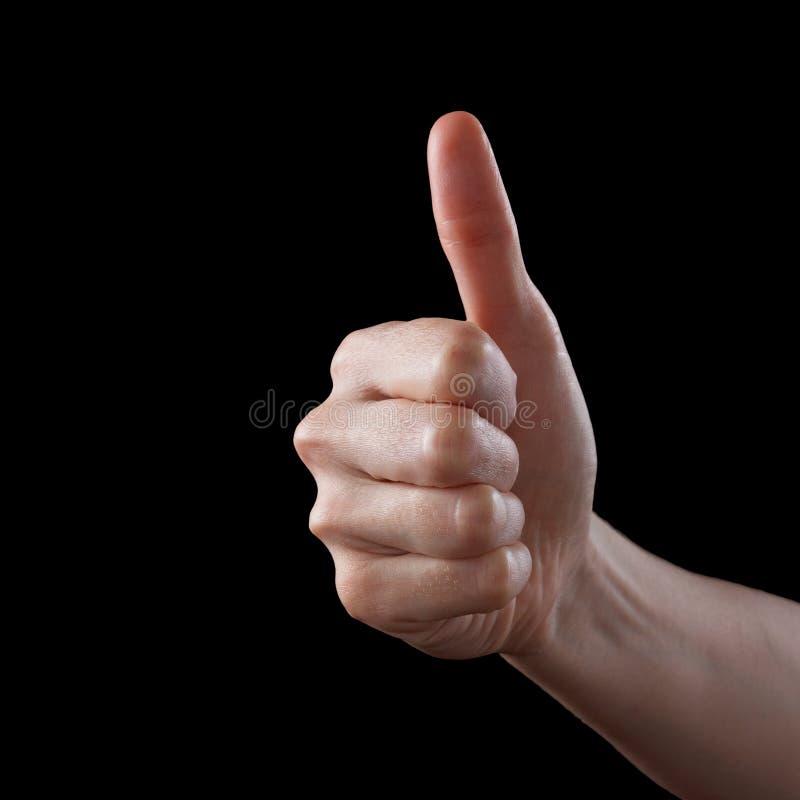 Polegares da aprovação acima como o sinal como o gesto de mão caucasiano isolado sobre o preto fotografia de stock