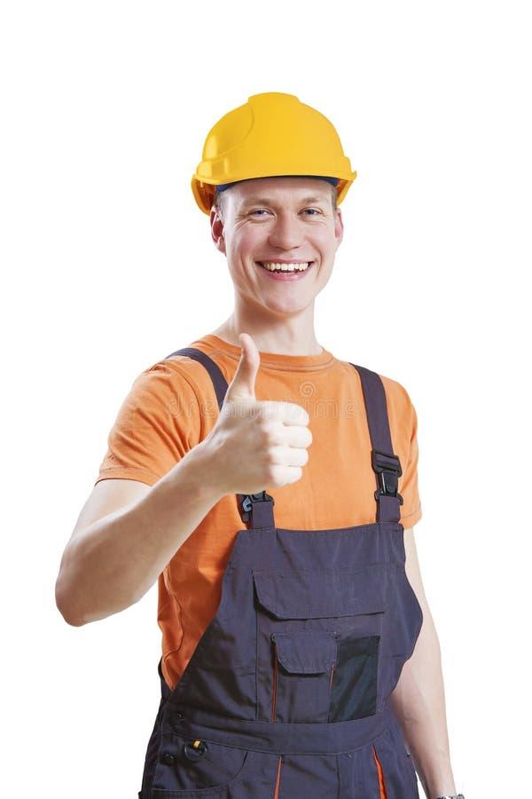 Polegares do trabalhador da construção acima foto de stock