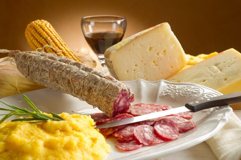 Polenta with salami stock image