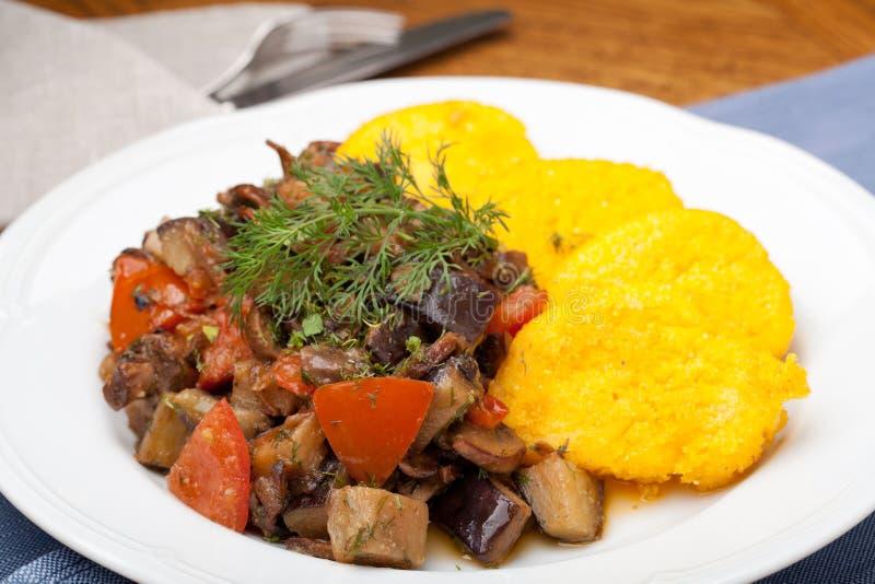 Polenta slices with vegetable stew royalty free stock photos