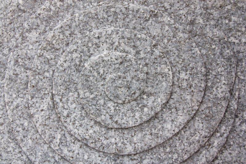 Polerad granit i viter grånar och svärtar arkivbilder