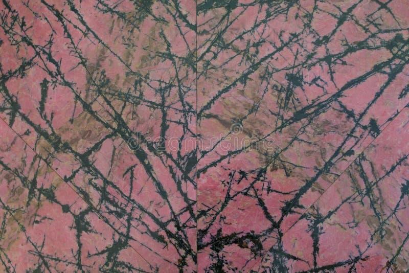 Polerad sten Rhodonite Rosa färger med svarta åder arkivfoton