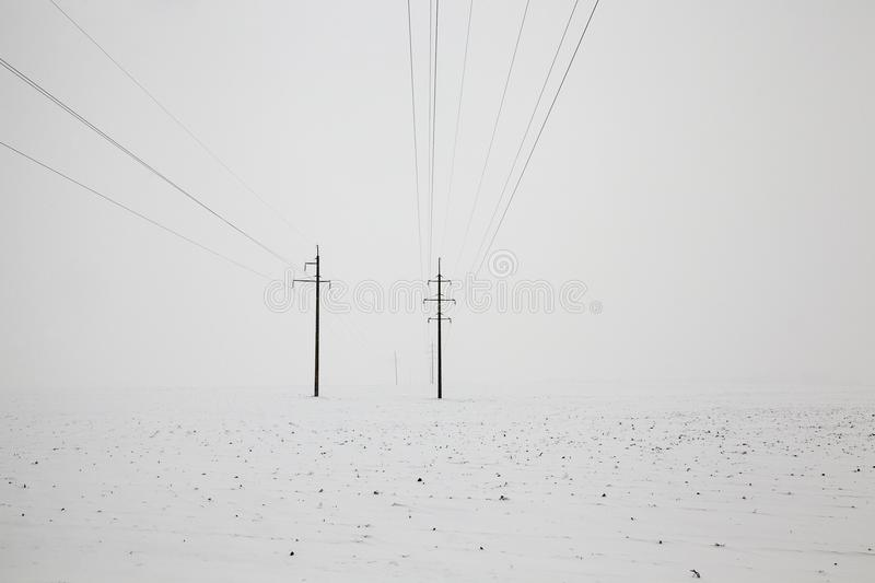 Poles with electric lines stock photography