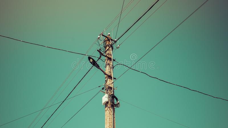 Poles with wires for the transfer of electricity. Poles with wires for electricity transmission, power lines stock photos