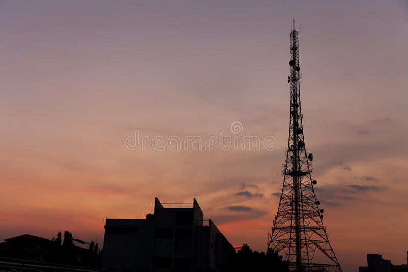 PoleTower in sunset. Telecommunication tower communication tower on sunset stock photo