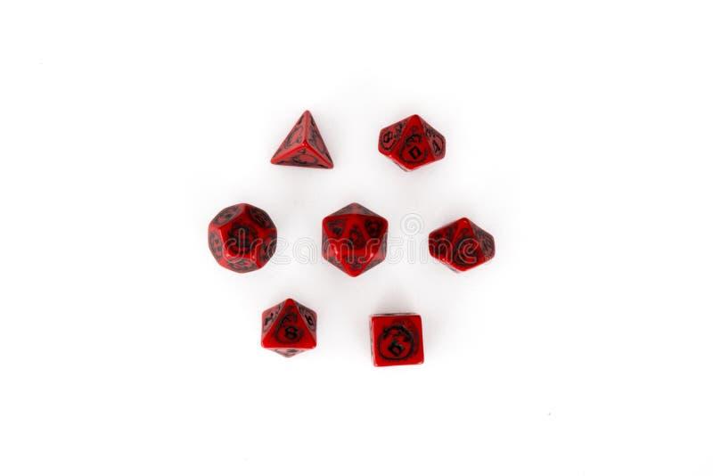Poli- kostki do gry ustawiający czerń i czerwień zdjęcie royalty free