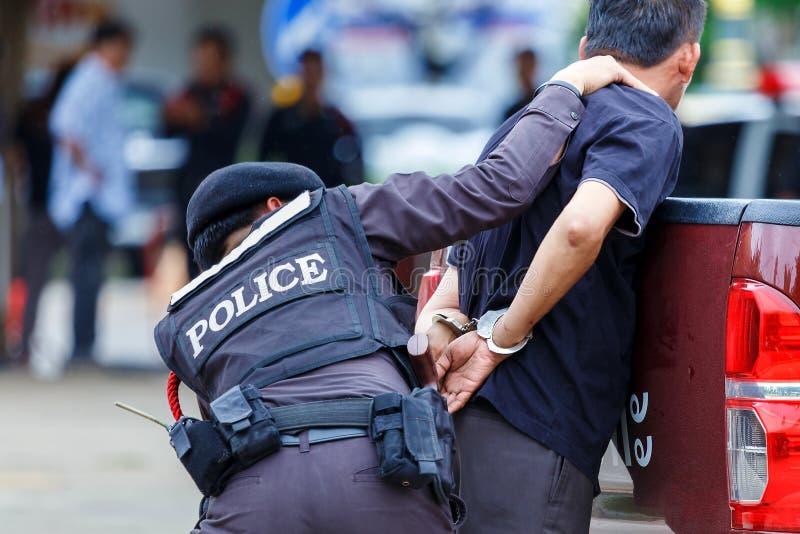Policía arrestada, policía, arma fotografía de archivo libre de regalías