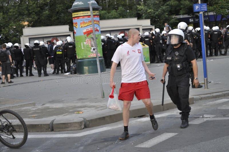 Policía del ventilador y de alboroto de fútbol imágenes de archivo libres de regalías