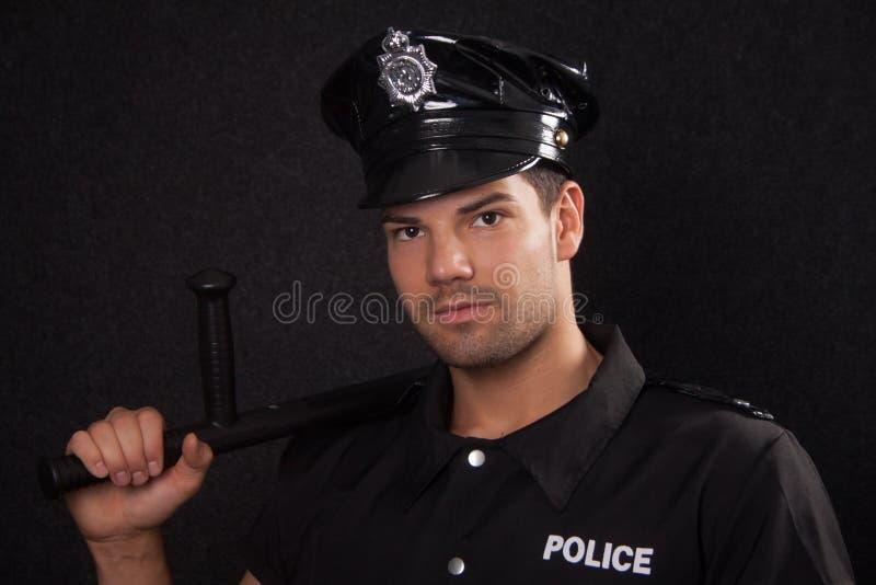 Policía joven con la veintiuna fotografía de archivo
