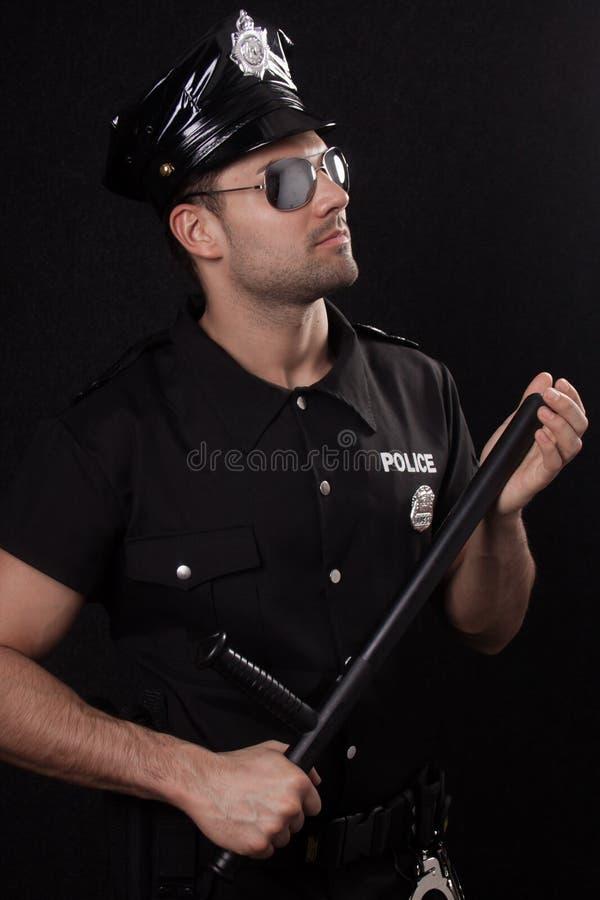 Policía joven en estudio imágenes de archivo libres de regalías