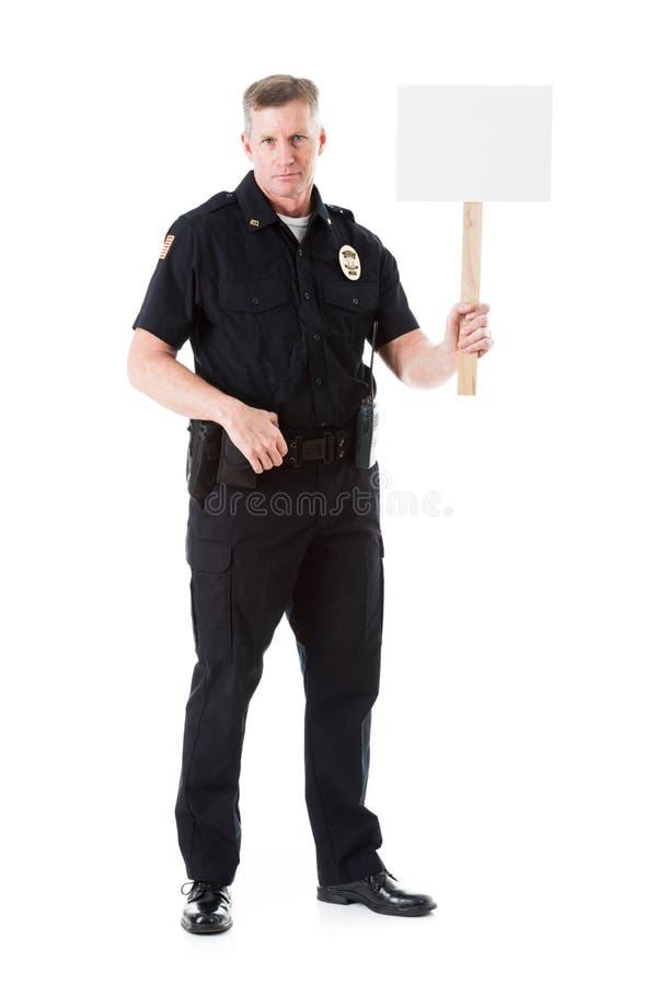 Policía: Muestra de Holds Up Blank del oficial en el palillo imagenes de archivo