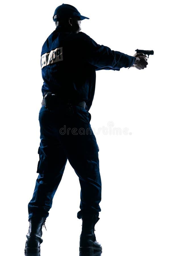 Policía que apunta la arma de mano fotografía de archivo libre de regalías