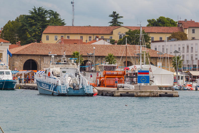 Police boat. Koper, Slovenia - September 19, 2015. Police motor boat parked in special sea dock of a town stock images