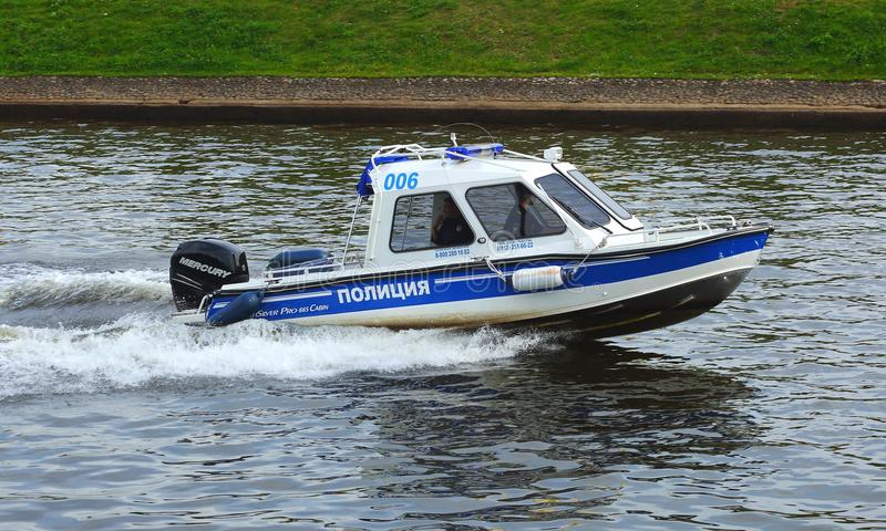 A police boat at speed. Is the Kronverksky canal, Saint-Petersburg, Russia royalty free stock photography