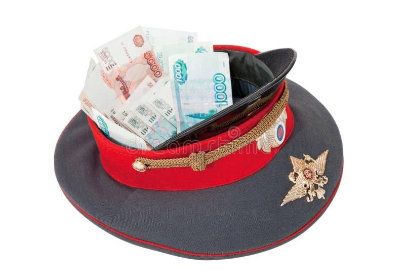 Police cap with money stock photo