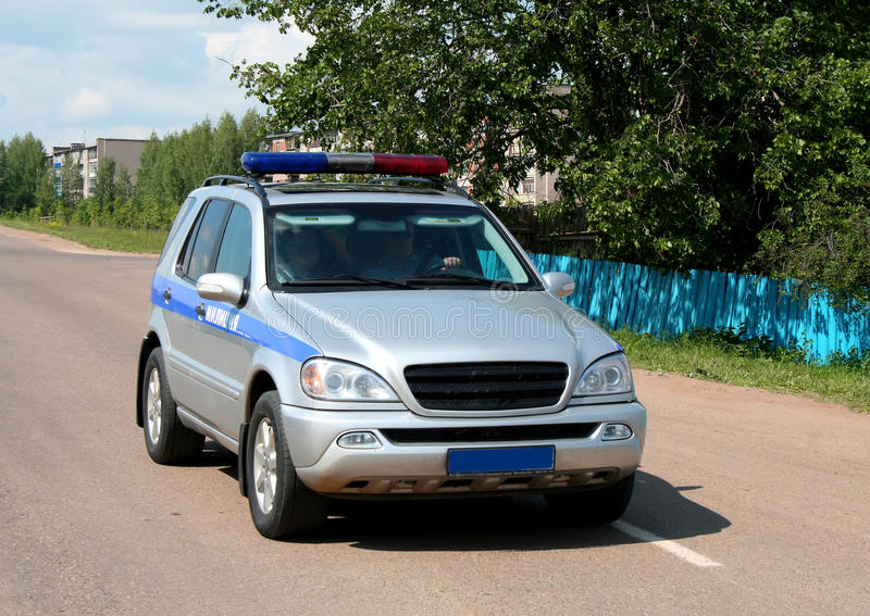 Police car. A grey and blue police car stock photography