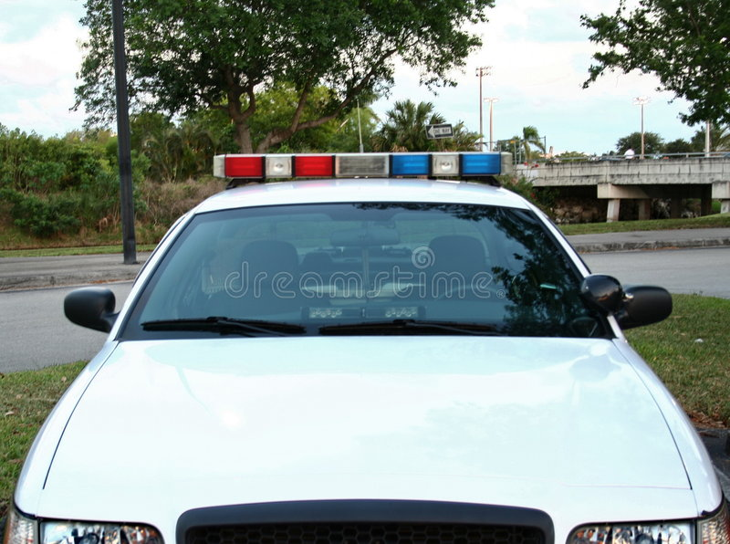 Police Car. In front of a police car in South Florida royalty free stock photography