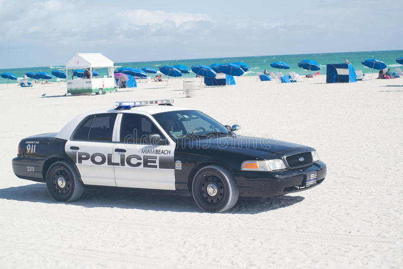 Police car on the beach royalty free stock photos