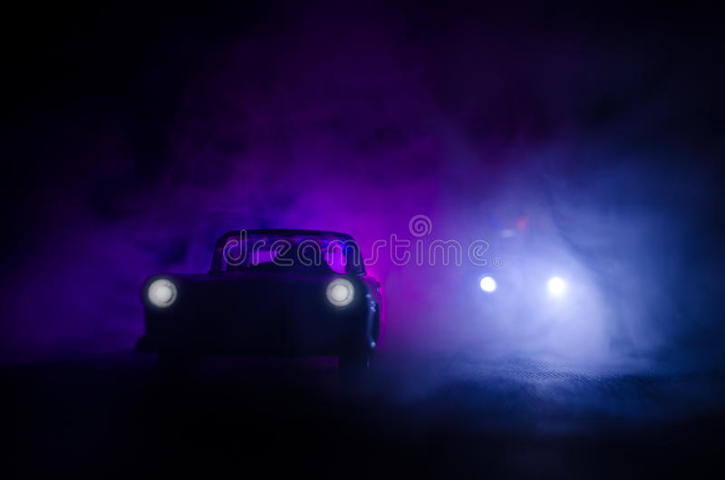Police car chasing a car at night with fog background. 911 Emergency response police car speeding to scene of crime. royalty free stock photos
