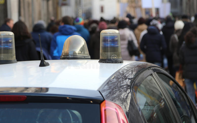 Police car escorted the protesters during a street protest. In the city stock images