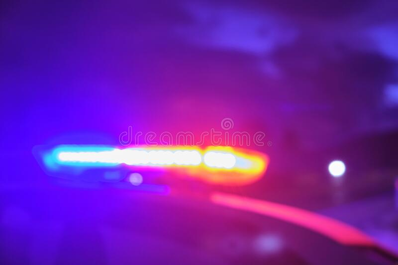 Police car flashing lights in the night blurred selective focus.  stock photography