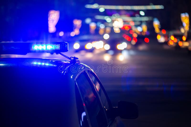 Police car lights at night in city with selective focus and bokeh stock image