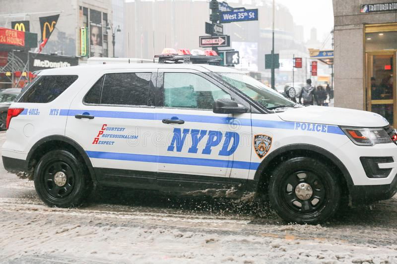 Police car in New York city street. New York - February 15, 2019:The New York City Police Department was established in 1845, and is the largest municipal royalty free stock photos