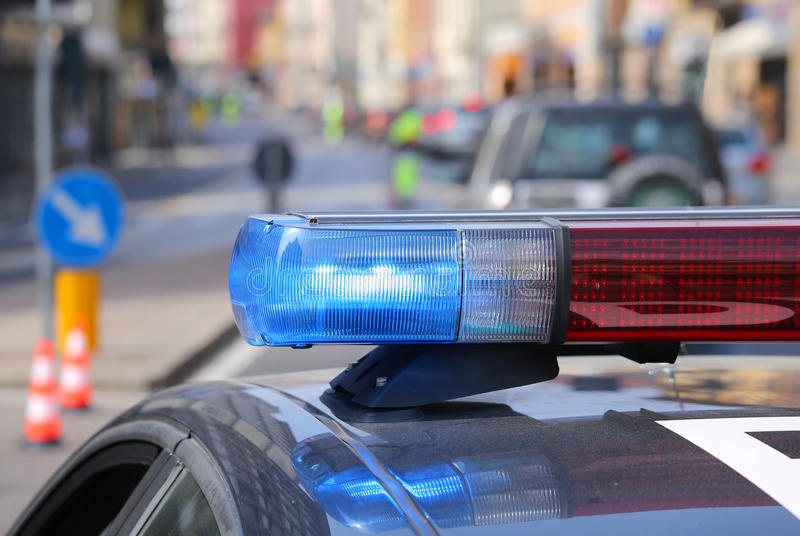 Police car with red and blue sirens in the checkpoint. In the road stock images