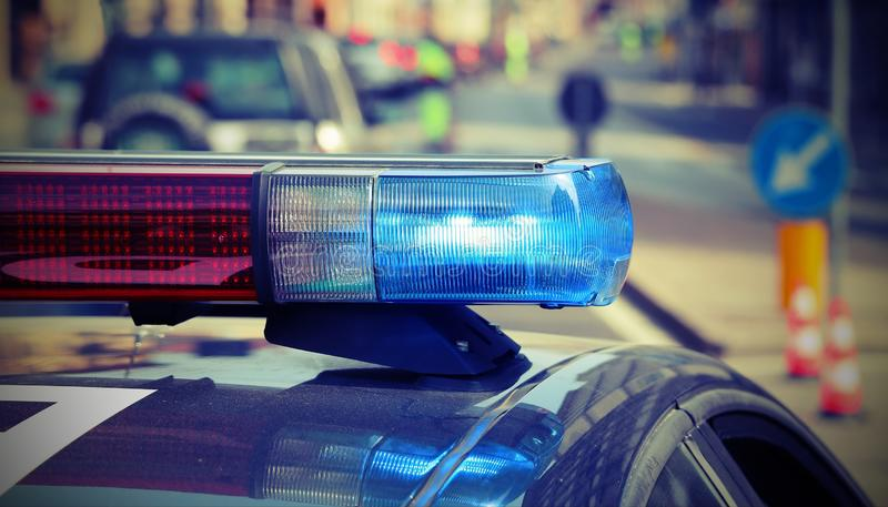 Police car with sirens in the checkpoint. Detail of police car with red and blue sirens in the checkpoin stock photos