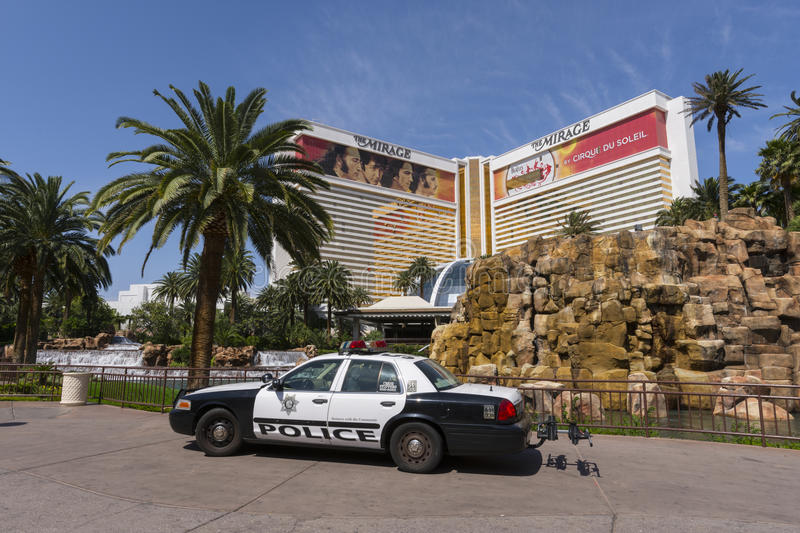 A police car sits in front of the Mirage hotel in Las Vegas. LAS VEGAS - MAY 7, 2015 - A metro Las Vegas police car sits on the sidewalk of the Mirage Hotel and royalty free stock photography