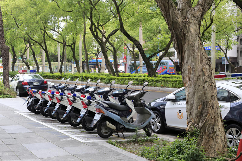 Police cars and motocycles placed neatly by the road stock photo