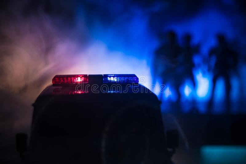 Police cars at night. Police car chasing a car at night with fog background. 911 Emergency response pSelective focus stock images