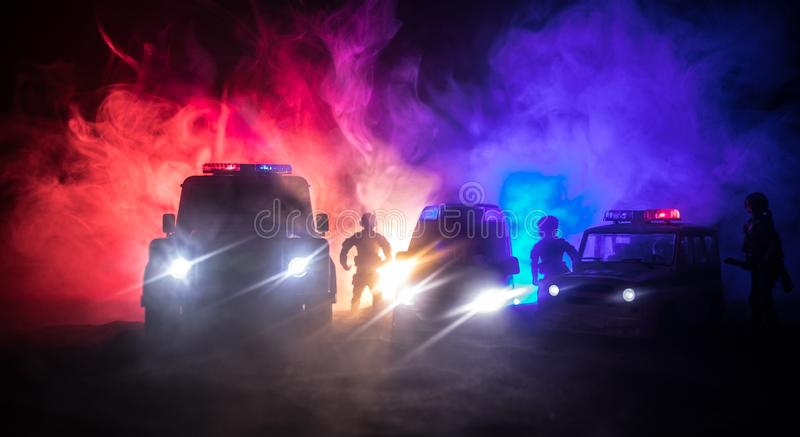 Police cars at night. Police car chasing a car at night with fog background. 911 Emergency response pSelective focus royalty free stock photo