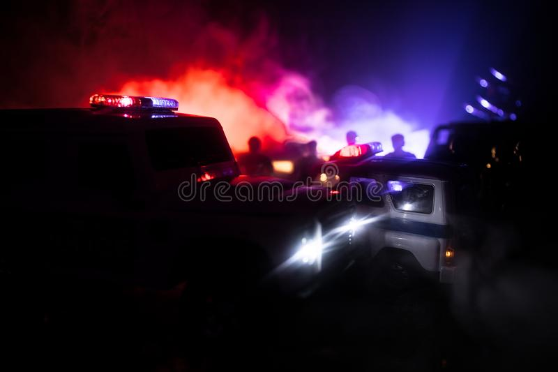 Police cars at night. Police car chasing a car at night with fog background. 911 Emergency response pSelective focus. Police cars at night. Police car chasing a stock photo