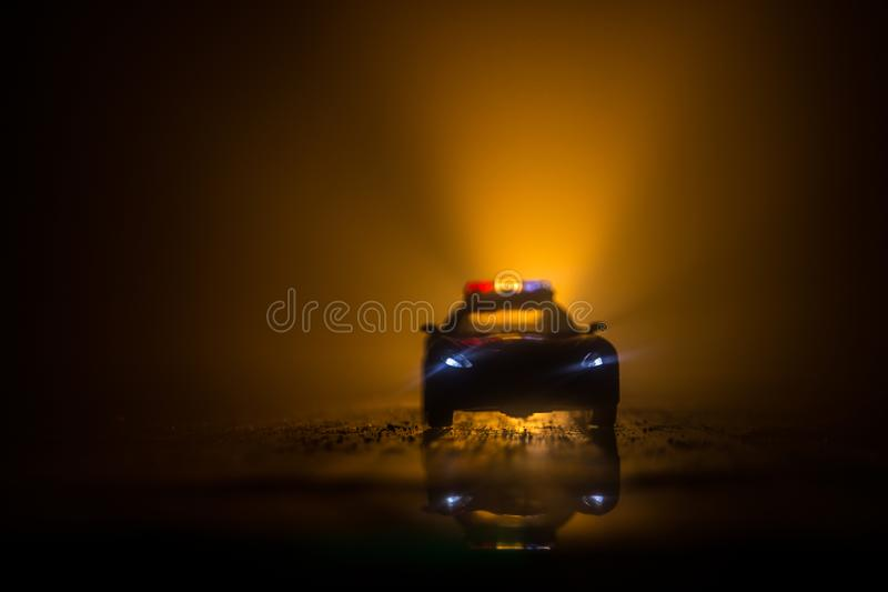 Police cars at night. Police car chasing a car at night with fog background. 911 Emergency response stock image
