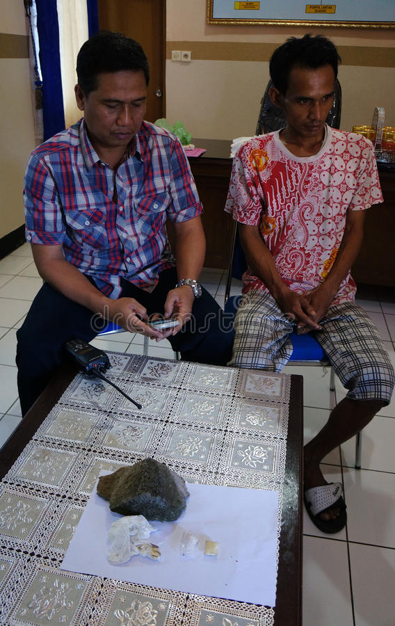 Police catch robber editorial image  Image of java, city