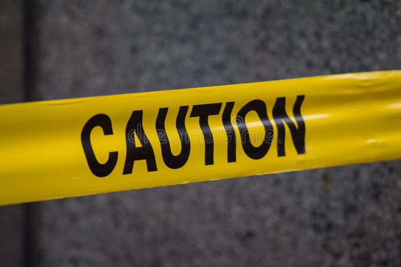 Police caution sign tape in city stock photography