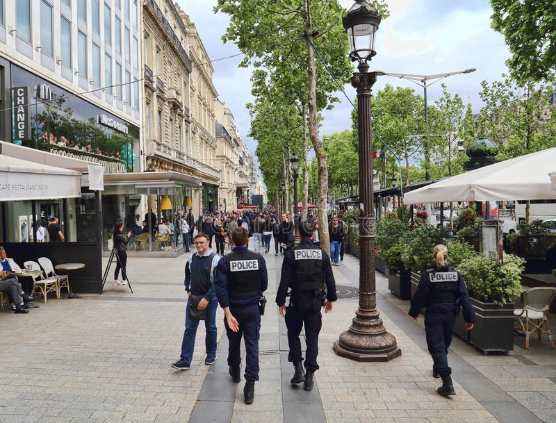 Police on the Champs-Elysees in Paris, France royalty free stock photo