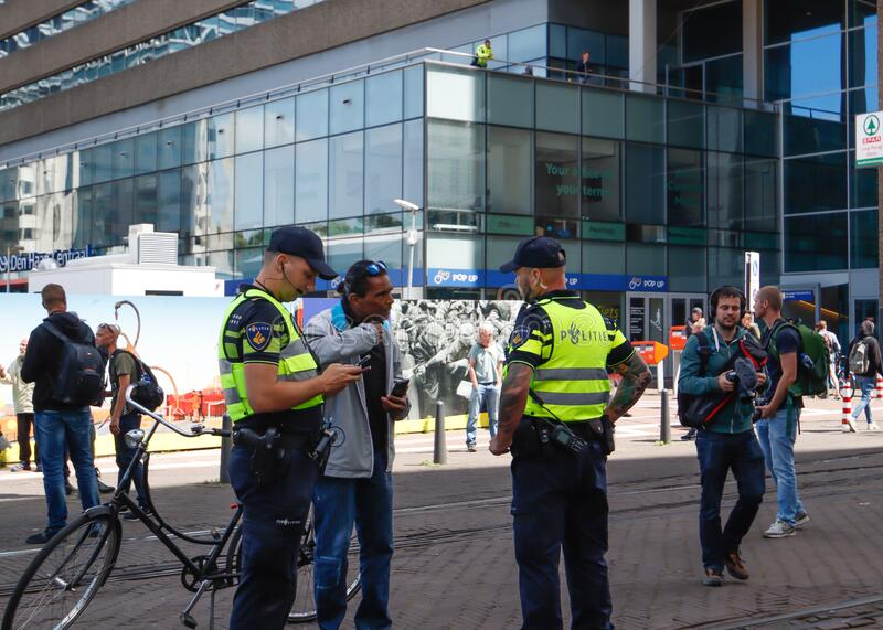 Police cordoning off area to stop people protesting on the streets against lockdown measures by the dutch government in the city royalty free stock photos