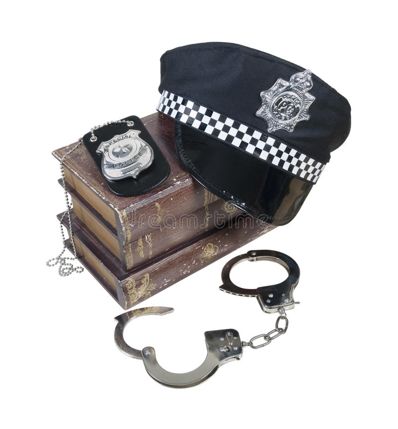 Police And Crime Books With Police Hat, Badge And Handcuffs Stock Photos
