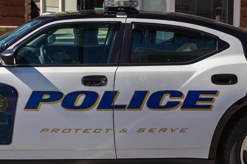 Police Cruiser. Side view of a standard American police cruiser utilized by law enforcement agencies royalty free stock image