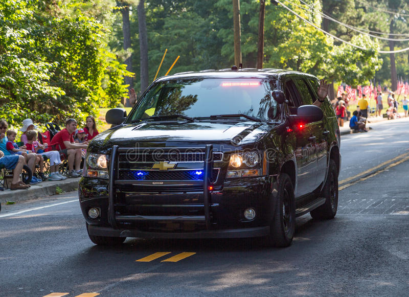 Download Police Cruiser Leading Parade Editorial Stock Image - Image of july, america: 90713999