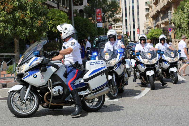 Police Escort Motorcyclists in Monaco. Monte-Carlo, Monaco - May 28, 2016: Four Motorcyclists of the Monaco Police during the Monaco Formula 1 Grand Prix 2016 royalty free stock photo