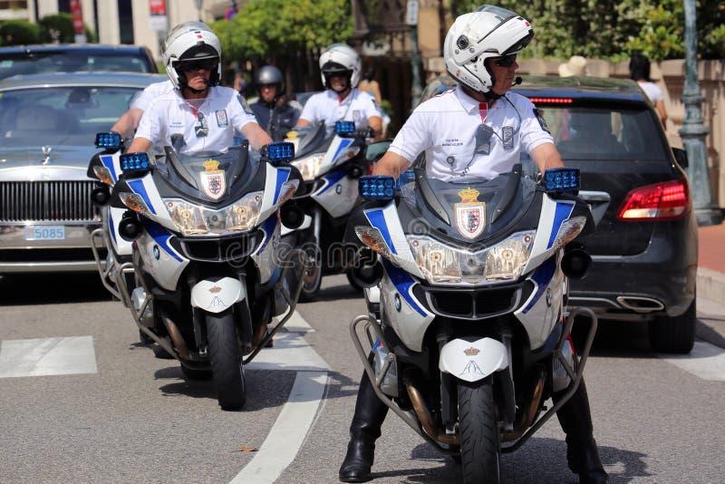 Police Escort Motorcyclists in Monaco. Monte-Carlo, Monaco - May 28, 2016: Four Motorcyclists of the Monaco Police during the Monaco Formula 1 Grand Prix 2016 stock images