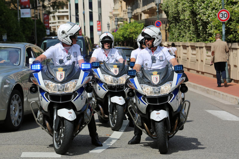 Police Escort Motorcyclists in Monaco. Monte-Carlo, Monaco - May 28, 2016: Four Motorcyclists of the Monaco Police during the Monaco Formula 1 Grand Prix 2016 stock photography
