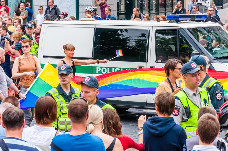 Police forces ensuring safety during the Pride parade on Gedimino street full of people. Event celebrating lesbian, gay, bisexual stock image