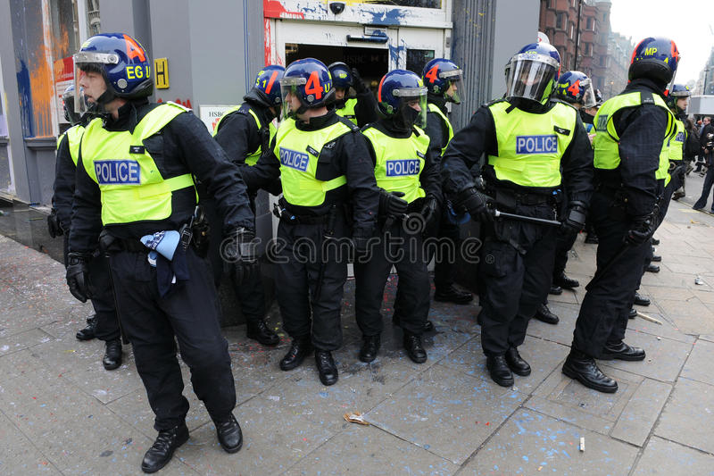 Police Guard a Vandalised Bank at a Riot in London royalty free stock images